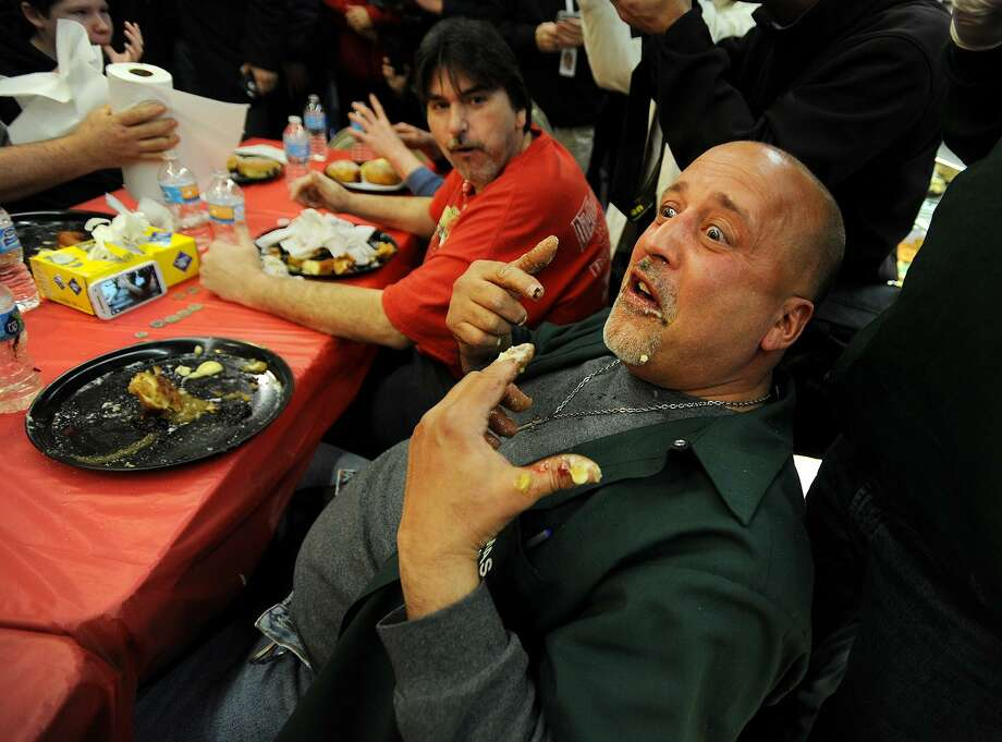 Vinny Mas, of Ansonia, reacts after finishing a plate of a paczkis, Polish filled doughnuts, during the 19th annual Paczki Eating Contest at Eddy's Bake Shop at 317 Main Street in Ansonia, Conn. on Tuesday, February 28, 2017. The paczkis weighed a half pound each. Photo: Brian A. Pounds / Hearst Connecticut Media / Connecticut Post