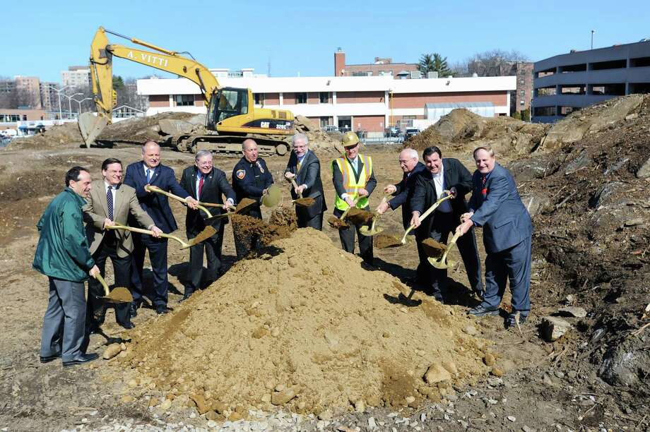 Stamford Mayor David Martin, fourth from left, joins police and city officials for a groundbreaking at the site of the new station on Bedford St. in Stamford, Conn. on Tuesday, Feb. 28, 2017. Photo: Michael Cummo / Hearst Connecticut Media / Stamford Advocate