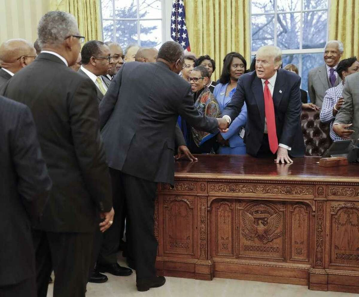 President Donald Trump shakes hands as he meets with leaders of Historically Black Colleges and Universities (HBCU) in the Oval Office of the White House in Washington, Monday, Feb. 27, 2017.