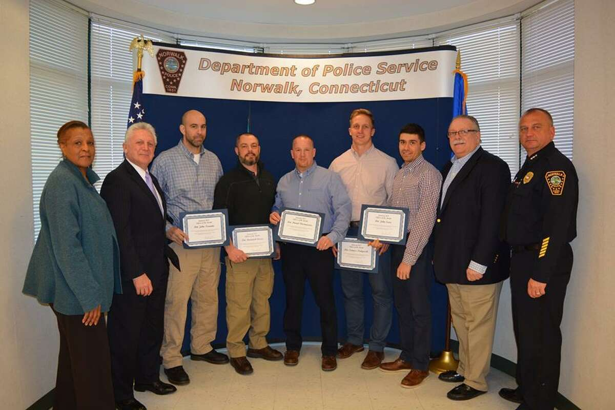 Eight Norwalk police officers were recognized as Officers of the Month at Monday night's Police Commission meeting for their roles in making arrests in a string of armed robberies. Pictured from left to right: Commissioner Fran Collier-Clemmons, Mayor Harry Rilling, detectives John Taranto, Dominick Cisero, Daniel Fitzmaurice, Tomasz Podgorksi, John Sura, Commissioner Charles Yost and Chief Thomas Kulhawik