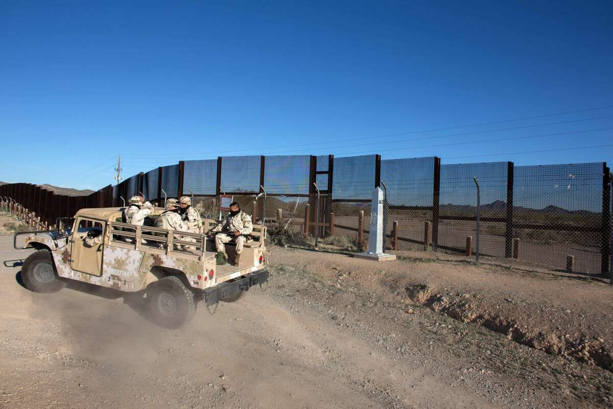 Mexico Mexican soldiers drive along a section of the US/Mexico border fence in Sonoyta, on February 16, 2017, northwestern Mexico.