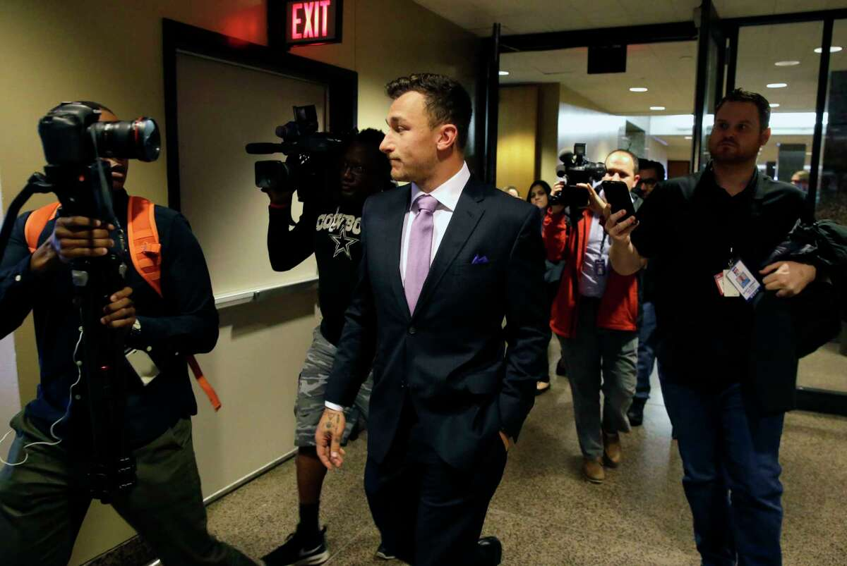 Former NFL quarterback Johnny Manziel walks down a hallway after a court hearing in Dallas, Tuesday, Feb. 28, 2017. (AP Photo/LM Otero)