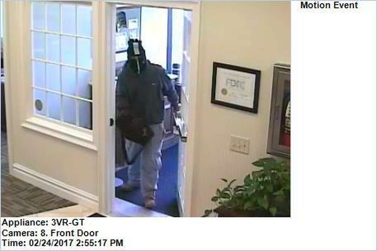Image of bank robbery suspect captured by video surveillance at the Fairfield County Bank on Friday.