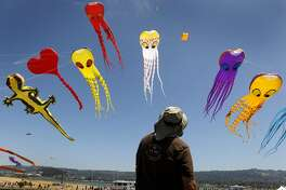 Dave Hoggan, of the Berkeley Kite Wranglers, monitors the flight of several giant inflatable kites at the annual kite festival at Cesar Chavez Park in Berkeley, Calif. on Saturday, July 28, 2012.