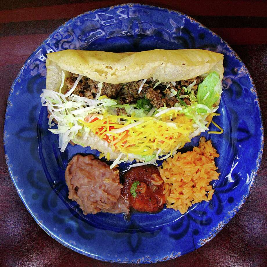 Beef picadillo puffy taco from Alejandro's Mexican Restaurant on West Commerce Street. Photo: Mike Sutter /San Antonio Express-News