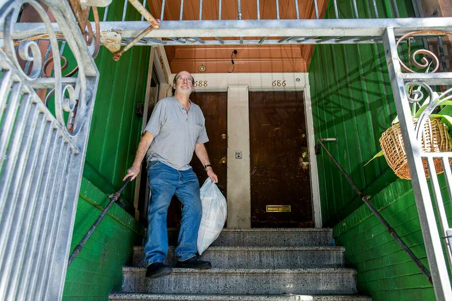 Landlord Mike Reed, who rents to a tenant with a Section 8 voucher, takes out the trash. Photo: Santiago Mejia, The Chronicle