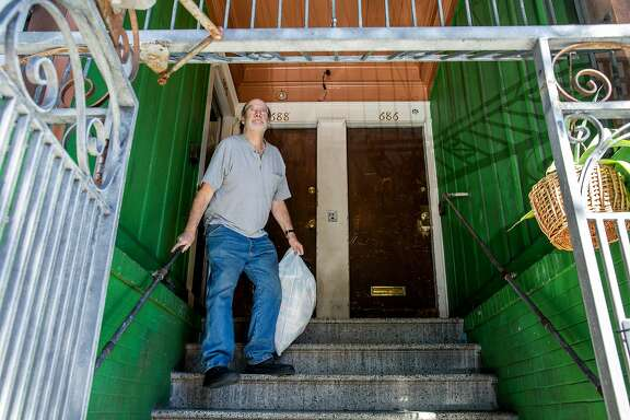 Mike Reed takes out the trash on Tuesday, Feb. 28, 2017, in San Francisco, Calif. Reed, the landlord, rents an apartment out to a tenant with a Section 8 voucher from the S.F. Housing Authority.