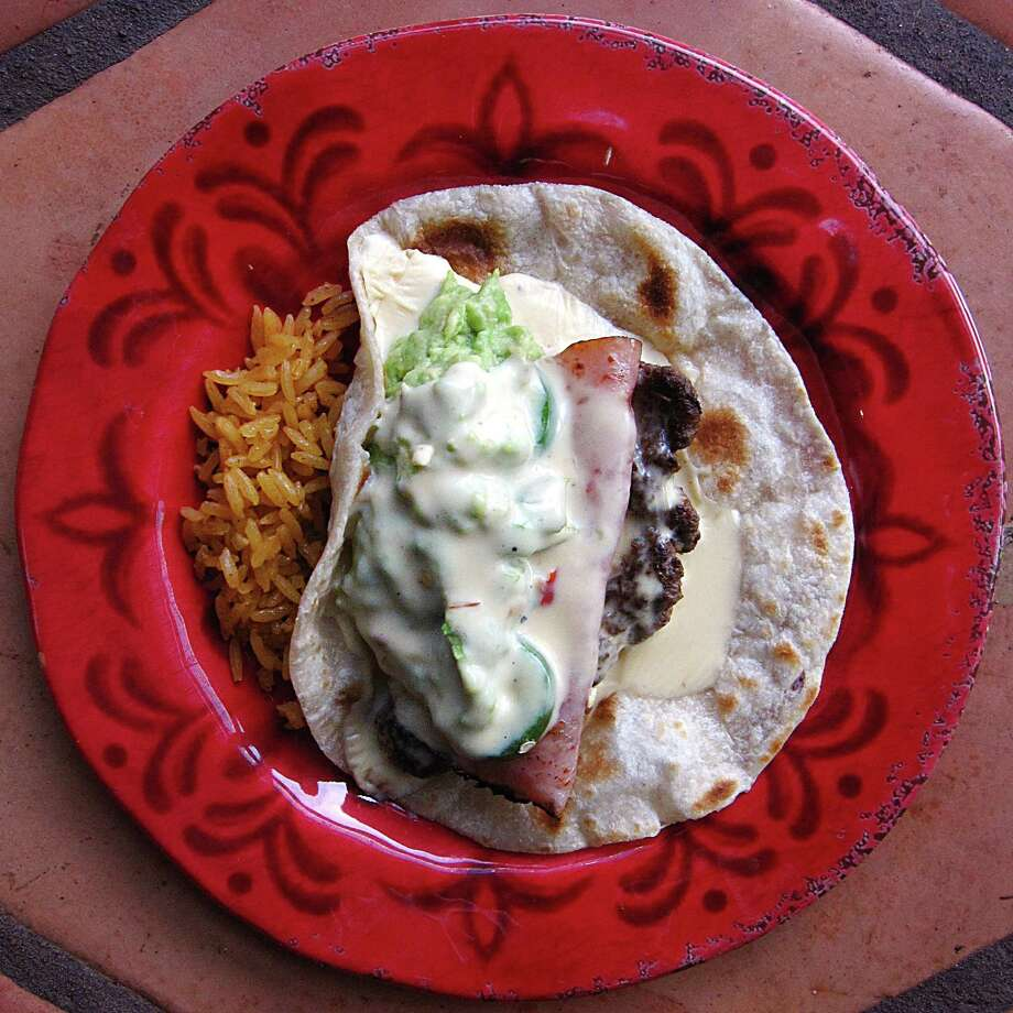 Mexican Cheeseburger Taco on a handmade flour tortilla from Chisme on North St. Mary's Street. Photo: Mike Sutter /San Antonio Express-News