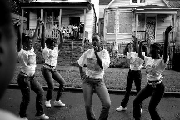 Carlos Javier Ortiz, Girls Dancing, Englewood, Chicago, 2008, archival pigment print, 20 x 26 inches, edition of 7. Courtesy of Jenkins Johnson Gallery