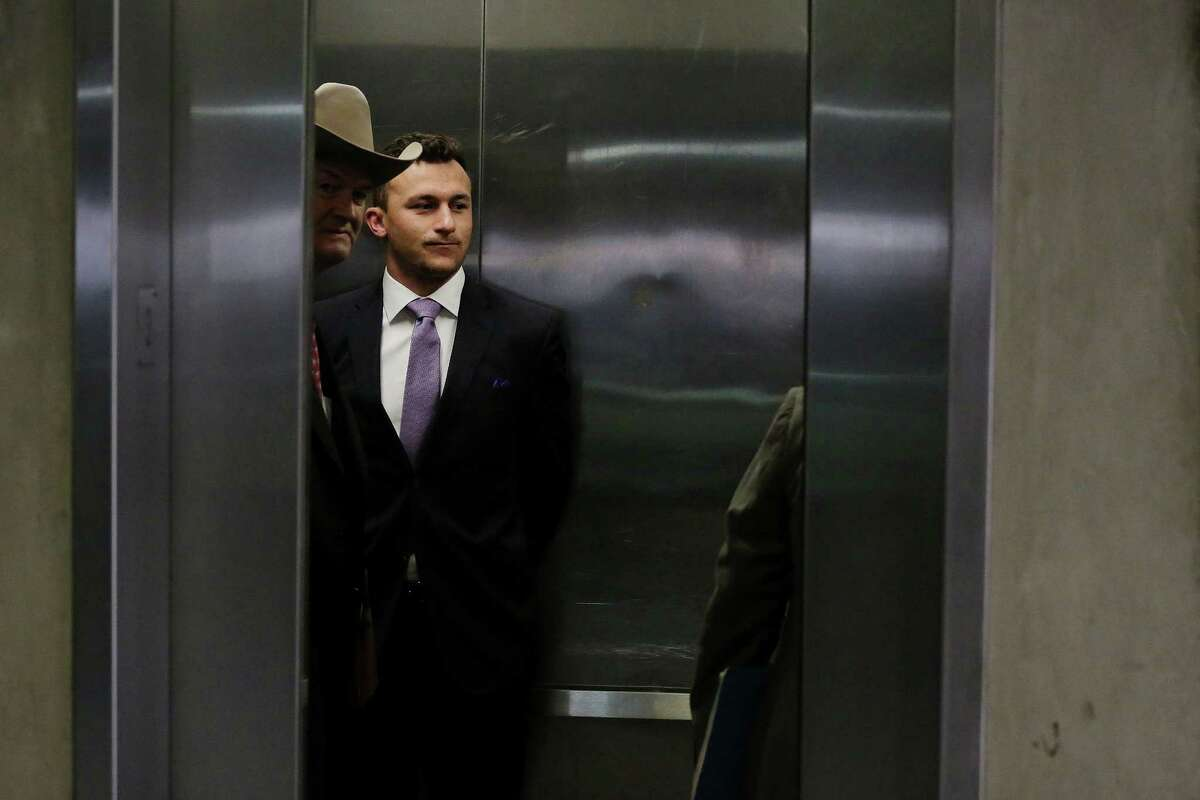 Former Texas A&M quarterback Johnny Manziel and defense attorney Jim Darnell enter an elevator in a parking structure following a hearing with judge Roberto Canas in Dallas County criminal court 10 at the Frank Crowley Courts Building in Dallas February 28, 2017. Manziel is in a hearing following an agreement reached with the county regarding his misdemeanor domestic violence case. (Andy Jacobsohn/The Dallas Morning News)