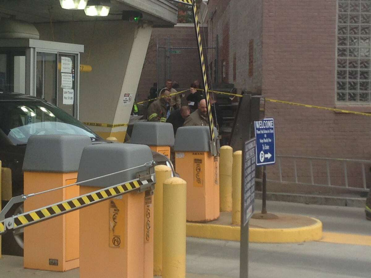 Schenectady police are investigating discovery of man's body found about 2:30 p.m. Tuesday next to a parking garage near an Italian bakery in the 200 block of Broadway. (Paul Nelson / Times Union)