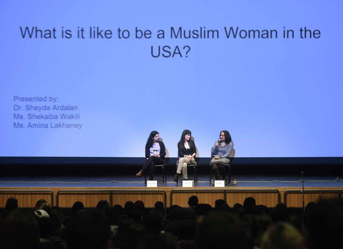 Muslim panelists Amina Lakhaney, left, Dr. Sheyda Ardalan, center, and Shekaiba Wakili speak during the