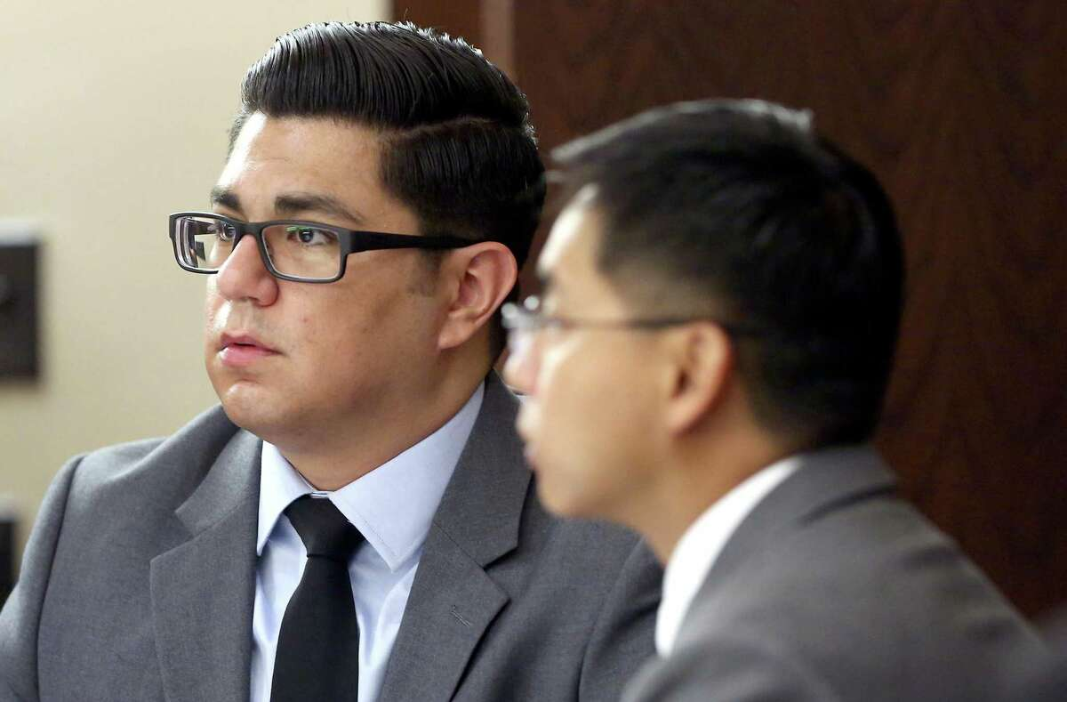 Former San Antonio Police officers Alejandro Chapa, left, and Emmanuel Galindo listen to testimony Tuesday, Feb. 28, 2017 during the first day of their trial in the 187th state District Court, presided by Judge Steven Hilbig. The former officers are on trial for charges of compelling prostitution. Chapa and Galindo are accused of recruiting and duping the women into having sex with them.