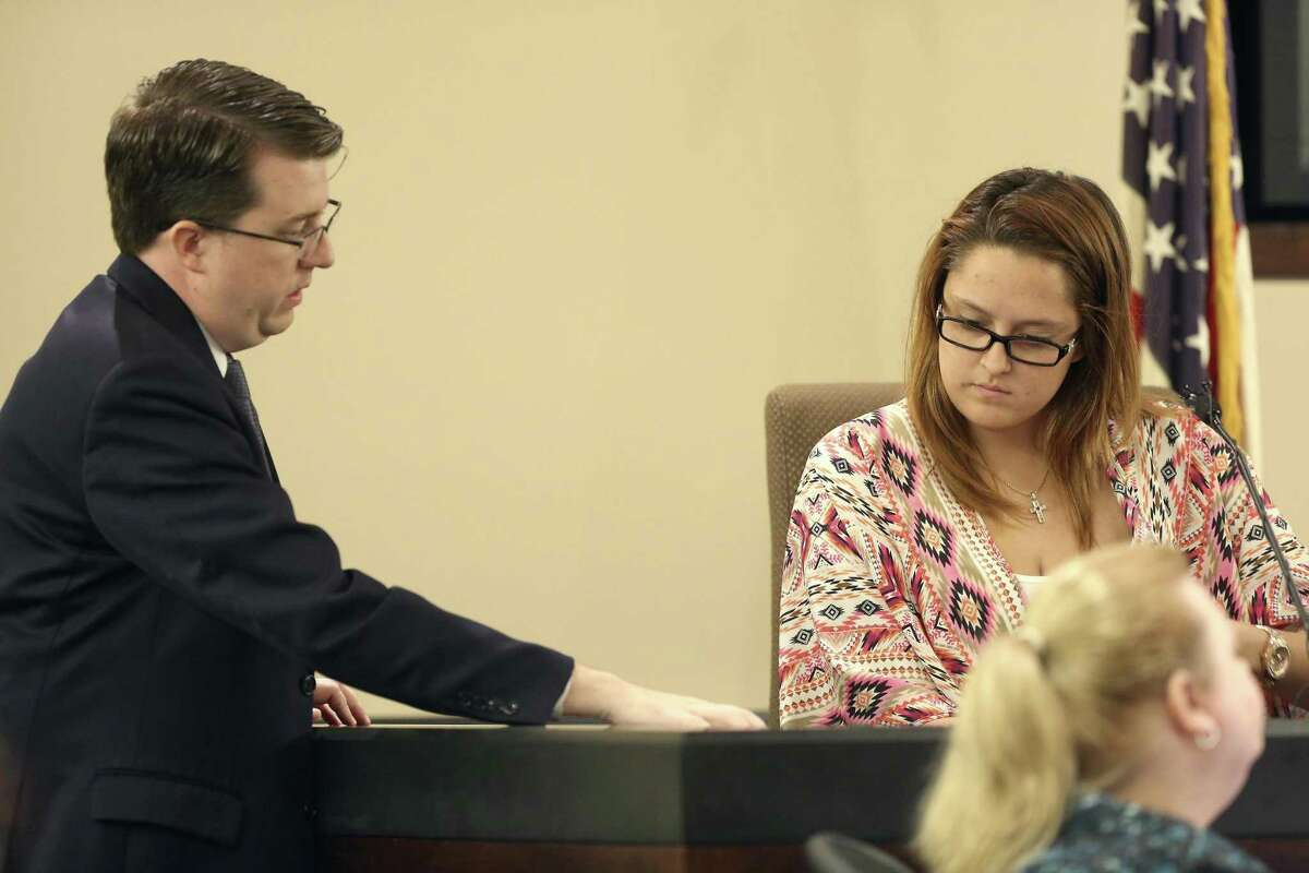 Prosecutor Ryan Wright, left, goes over a document Tuesday, Feb. 28, 2017, with witness Serena Fullerton in 187th state District Court, presided by Judge Steven Hilbig, during the trial of former San Antonio Police officers Alejandro Chapa and Emmanuel Galindo. The former officers are on trial for charges of compelling prostitution, accused of recruiting and duping the women into having sex with them.
