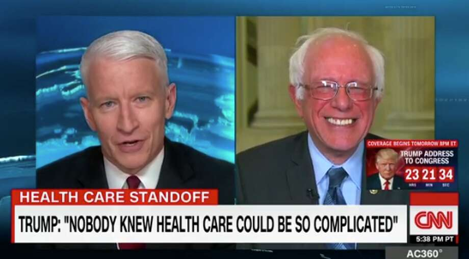A screenshot from CNN's interview with Sen. Bernie Sanders, I-Vt., shows the senator laughing after hearing one of President Trump's most recent claims.Click through this slideshow to read more about President Trump's first 100 days in office. Photo: Screenshot Via CNN