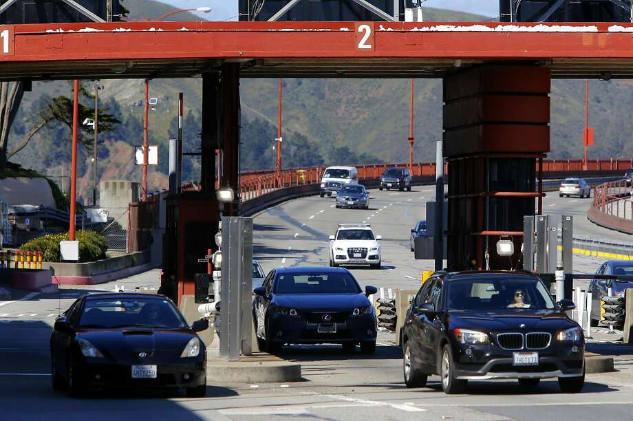 Vehicles pass through the automated toll plaza at the south end of the Golden Gate Bridge. Photo: Michael Macor, The Chronicle