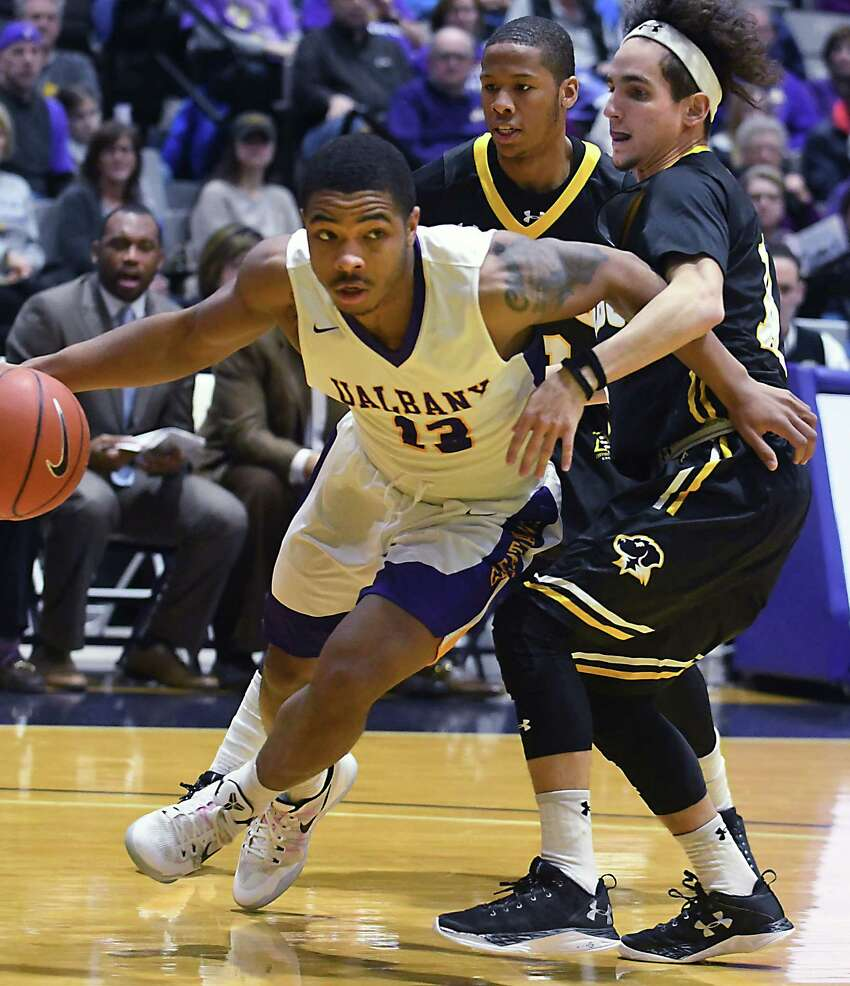 University at Albany's David Nichols drives to the basket and scores two points during a basketball game against UMBC at the SEFCU Arena on Wednesday, Feb. 15, 2017 in Albany, N.Y. (Lori Van Buren / Times Union)