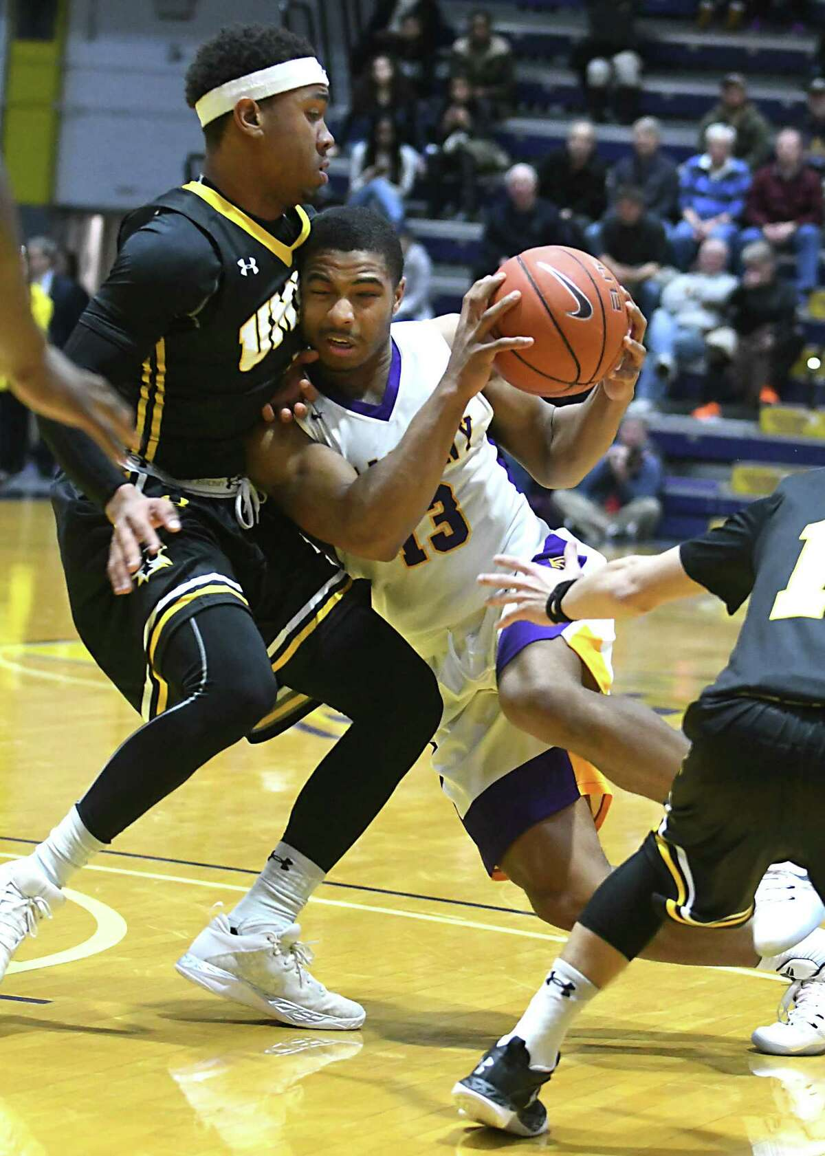 University at Albany's David Nichols is defended by UMBC's Rodney Elliot as he drives to the basket during a basketball game at the SEFCU Arena on Wednesday, Feb. 15, 2017 in Albany, N.Y. (Lori Van Buren / Times Union)