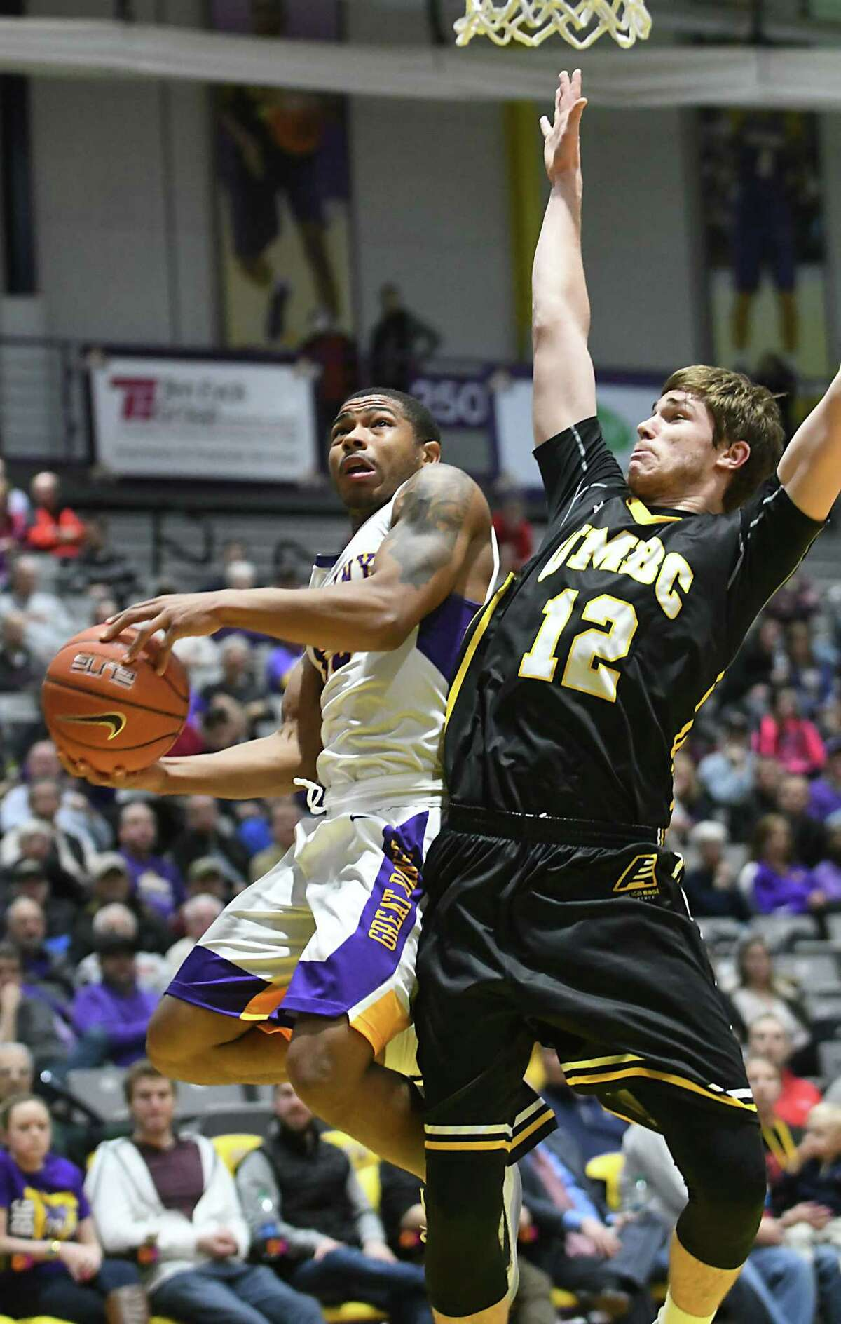 University at Albany's David Nichols is defended by UMBC's Will Darley as he drives to the hoop during a basketball game at the SEFCU Arena on Wednesday, Feb. 15, 2017 in Albany, N.Y. (Lori Van Buren / Times Union)