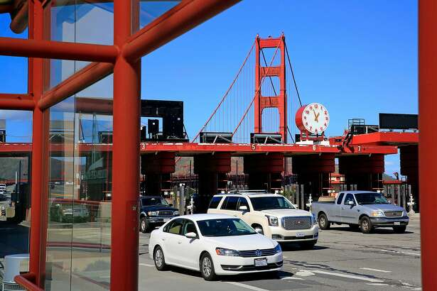 Vehicles pass through the automated toll plaza at the south end of the Golden Gate Bridge in San Francisco, Ca. on Tuesday February 28, 2017.