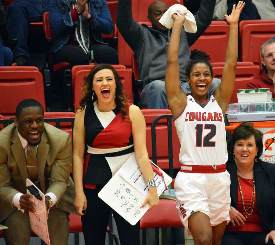 SIUE guard Lauren White (No. 12) celebrates on the bench during a win over Eastern Illinois on Saturday.