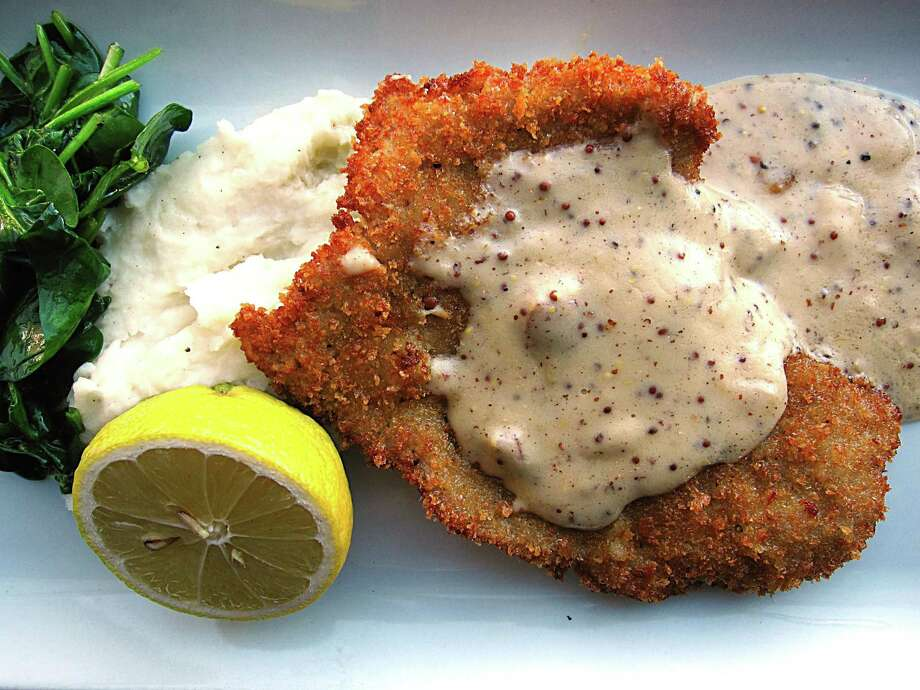 Veal schnitzel with mashed potatoes, wilted spinach and andouille gravy at Bryans on 290 in Johnson City. Photo: Mike Sutter /San Antonio Express-News