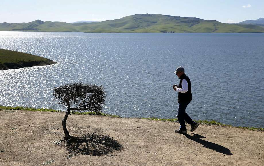 Marc Eldridge stops on his way to Los Banos to view San Luis Reservoir, which is close to full capacity, in Gustine, Calif. on Tuesday, Feb. 28, 2017. The federal Bureau of Reclamation announced water allocations for the Central Valley on Tuesday. Photo: Paul Chinn, The Chronicle