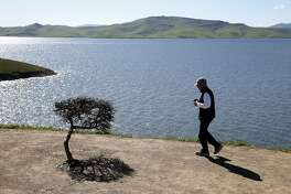 Marc Eldridge stops on his way to Los Banos to view San Luis Reservoir, which is close to full capacity, in Gustine, Calif. on Tuesday, Feb. 28, 2017. The federal Bureau of Reclamation announced water allocations for the Central Valley on Tuesday.
