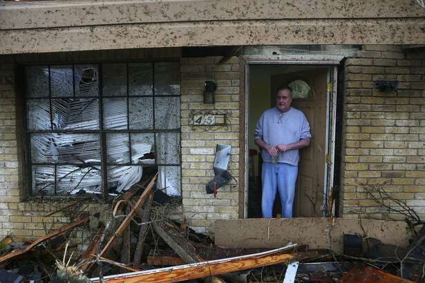 Greg Goza stands in the doorway of his mother-in-law's home after a tornado swept through a neighborhood in North Central San Antonio recently. A reader applauds the city for coming to the aid of the tornado victims.