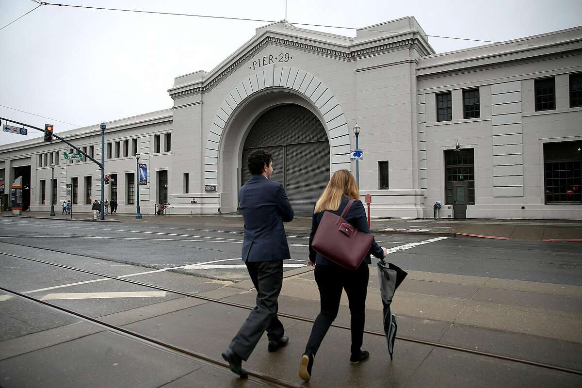 Joshua Callahan (left) who leads the San Francisco project and project manager Remy Monteko (right) of the bulkhead at Pier 29 head to their project on Tuesday, February 7, 2017, in San Francisco, Calif.