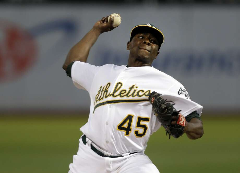 FILE - In this Sept. 19, 2016, file photo, Oakland Athletics pitcher Jharel Cotton works against the Houston Astros in the first inning of a baseball game in Oakland, Calif. Cotton showed why the A's acquired him when they dealt Josh Reddick and Rich Hill to the Dodgers at the trade deadline last summer. The hard-throwing right-hander went 2-0 with a 2.15 ERA and 23 strikeouts to four walks in five starts.  (AP Photo/Ben Margot, File) Photo: Ben Margot, Associated Press