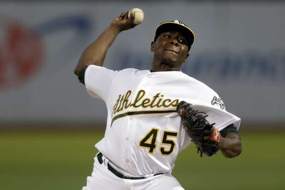 FILE - In this Sept. 19, 2016, file photo, Oakland Athletics pitcher Jharel Cotton works against the Houston Astros in the first inning of a baseball game in Oakland, Calif. Cotton showed why the A�s acquired him when they dealt Josh Reddick and Rich Hill to the Dodgers at the trade deadline last summer. The hard-throwing right-hander went 2-0 with a 2.15 ERA and 23 strikeouts to four walks in five starts.  (AP Photo/Ben Margot, File)