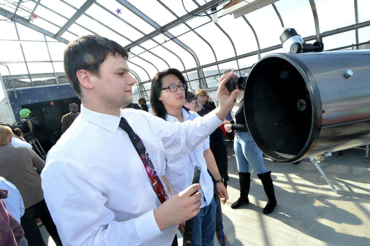 Teacher Advisor Marco Minnocci and senior Jay Bitsky look over the reflecting telescope, the largest of the new telescopes at the Norwalk High School observatory that opened on Tuesday February 28, 2017 in Norwalk Conn.. Michael Belmonte?'s astronomy class worked to refurbish the greenhouse space at the school to transform it into a full-fledged observatory on the roof of the school