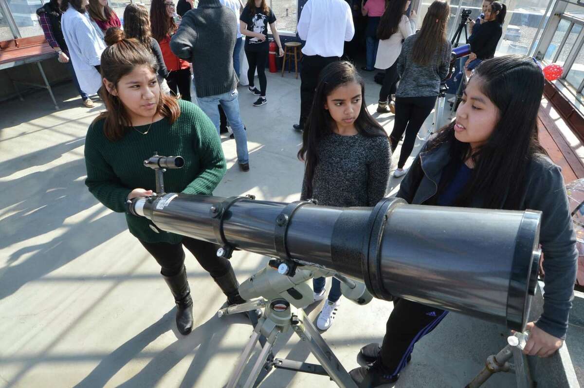 Elizabeth Garcia, Angelino Weyman and Karina Catalan get a feel for one of the telescopes at the Norwalk High School observatory that opened on Tuesday February 28, 2017 in Norwalk Conn.. Michael Belmonte?'s astronomy class worked to refurbish the greenhouse space at the school to transform it into a full-fledged observatory on the roof of the school