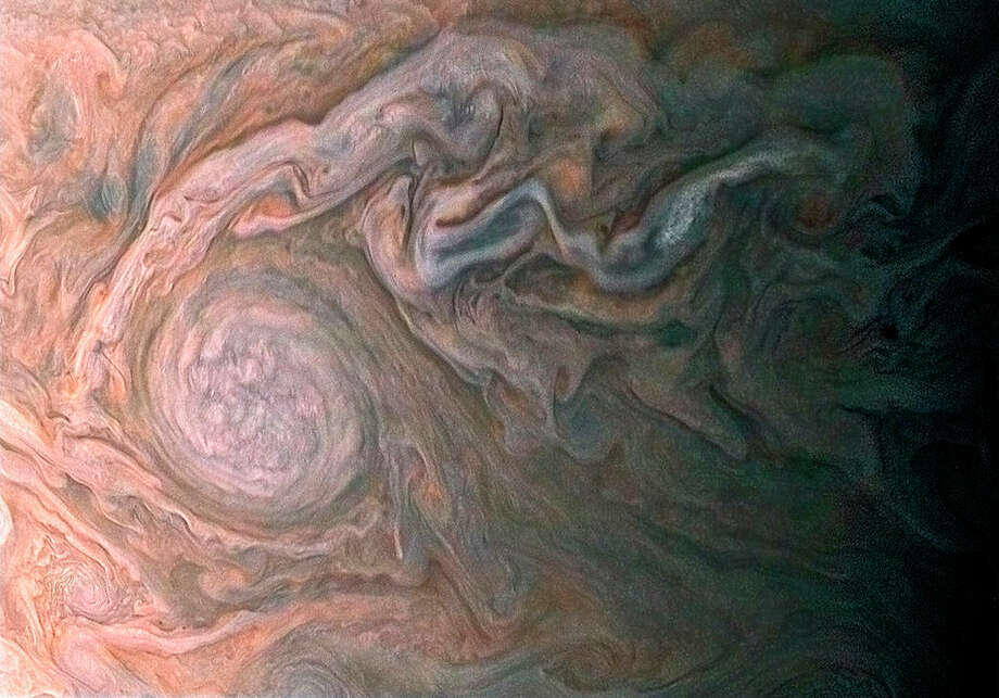 The Junocam is a color-imaging eye pointed at the Jovian planet. Its gaze is be mostly directed by the public via a public-voting platform. The camera then takes raw images of areas both directed by the public and scientists. Once the images are uploaded, citizens with little to read or watch or otherwise distract themselves with other than news about the new U.S. president are invited to modify the images and upload them to the NASA website. Here are some to enjoy.Citizen image (NASA caption): NASA's Juno spacecraft skimmed the upper wisps of Jupiter's atmosphere when JunoCam snapped this image on Feb. 2 at 5:13 a.m. PT (8:13 a.m. ET), from an altitude of about 9,000 miles (14,500 kilometers) above the giant planet's swirling cloudtops. Streams of clouds spin off a rotating oval-shaped cloud system in the Jovian southern hemisphere. Citizen scientist Roman Tkachenko reconstructed the color and cropped the image to draw viewers' eyes to the storm and the turbulence around it.  Photo: NASA/JPL-Caltech/SwRI/MSSS/Roman Tkachenko