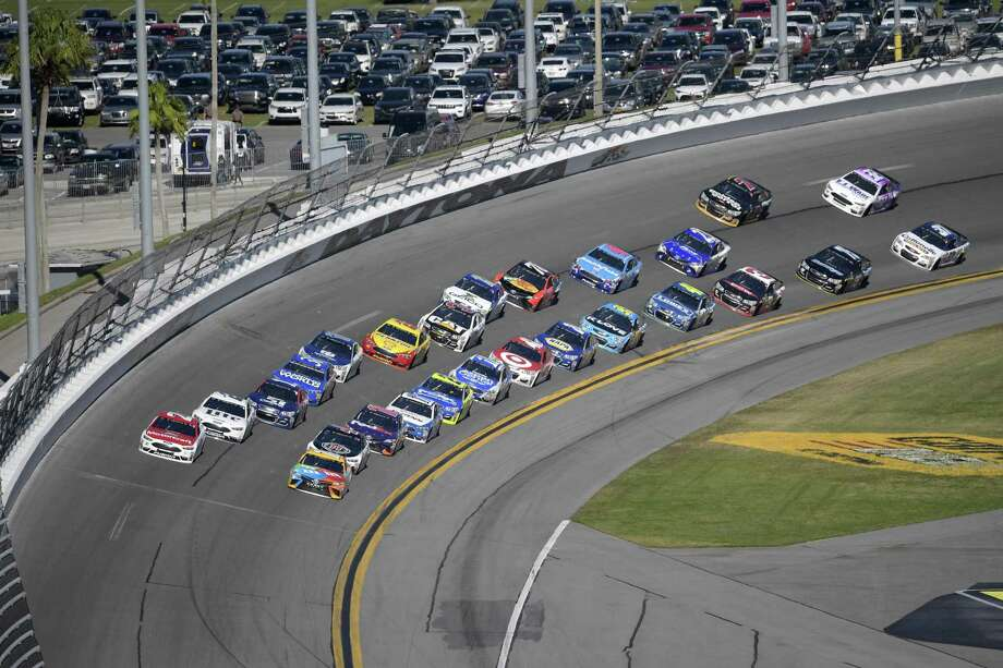 Ryan Blaney (21), front left, and Kyle Busch (18) lead a pack of drivers through Turn 4 during the NASCAR Daytona 500 auto race at Daytona International Speedway, Sunday, Feb. 26, 2017, in Daytona Beach, Fla. (AP Photo/Phelan M. Ebenhack) Photo: Phelan M. Ebenhack, FRE / Associated Press / FR121174 AP