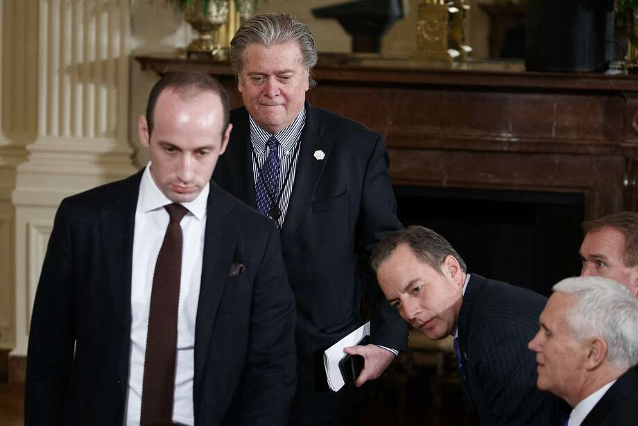 Senior staff to President Donald Trump arrive for a news conference in the East Room of the White House in Washington, Thursday, Feb. 16, 2017. From left are, Senior Policy Adviser Stephen Miller, White House Chief Strategist Steve Bannon, White House Chief of Staff Reince Priebus, and Vice President Mike Pence. (AP Photo/Evan Vucci) Photo: Evan Vucci, Associated Press