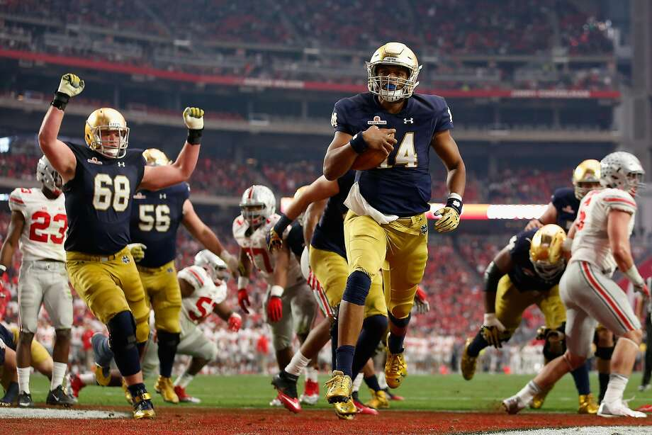 Quarterback DeShone Kizer #14 of the Notre Dame Fighting Irish scores on a one yard rushing touchdown against the Ohio State Buckeyes. Photo: Christian Petersen, Getty Images