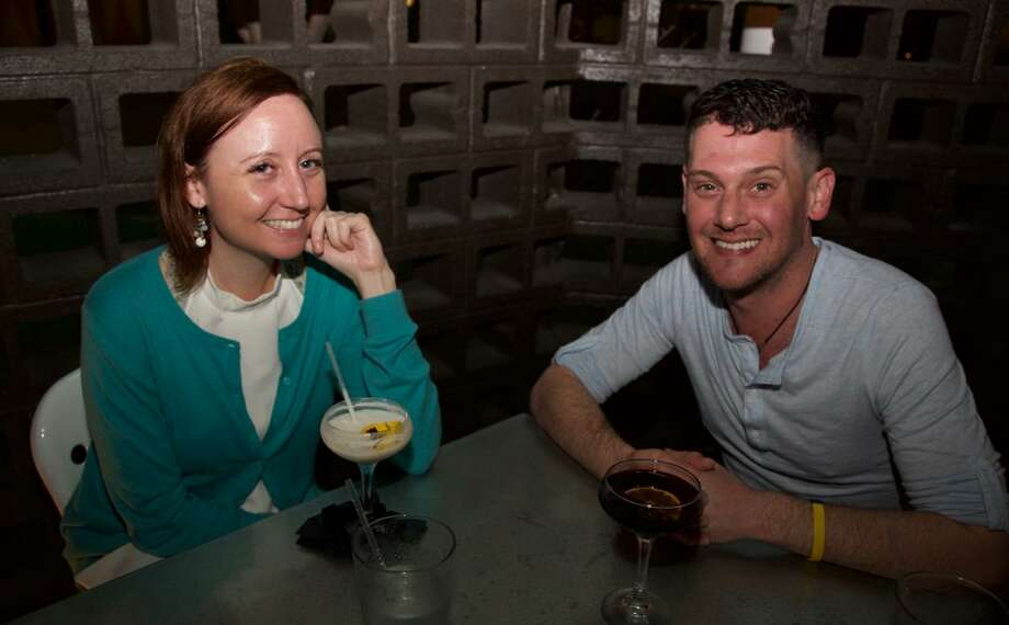 Ali Carpenter and Brett Abbott are at Chisme, a trendy new spot on the St. Mary's Strip. Photo: Xelina Flores / For The Express-News