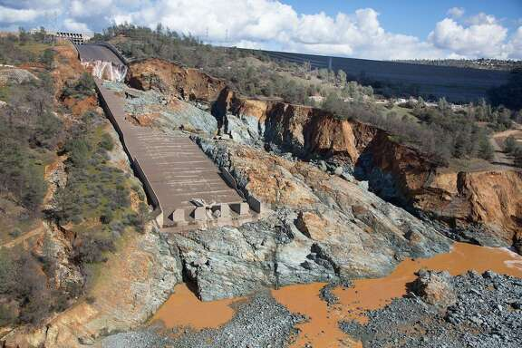 The Oroville Dam's concrete spillway needs major repairs after an enormous section of the channel was ruined in recent rains.