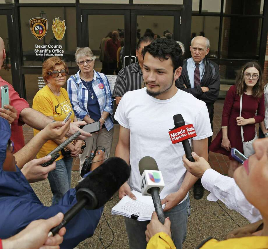 DACA student Josue Romero, center, who was recently transferred to ICE custody by the Bexar County Sheriff's Department  address media outside the department's headquarters where he presented a petition consisting of close to 3,000 signatures demanding Sheriff Salazar end his voluntary cooperation with ICE. Photo: Ron Cortes, Freelance / For The San Antonio Express-News