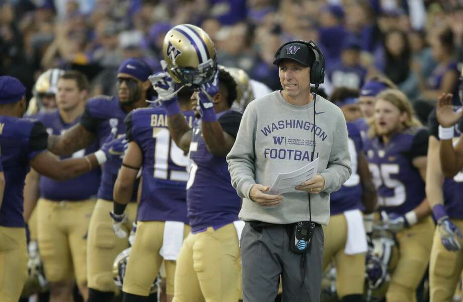 Washington offensive line coach Chris Strausser stands on the sideline during an NCAA college football game against Stanford, Friday, Sept. 30, 2016, in Seattle. (AP Photo/Ted S. Warren) Photo: Ted S. Warren/AP
