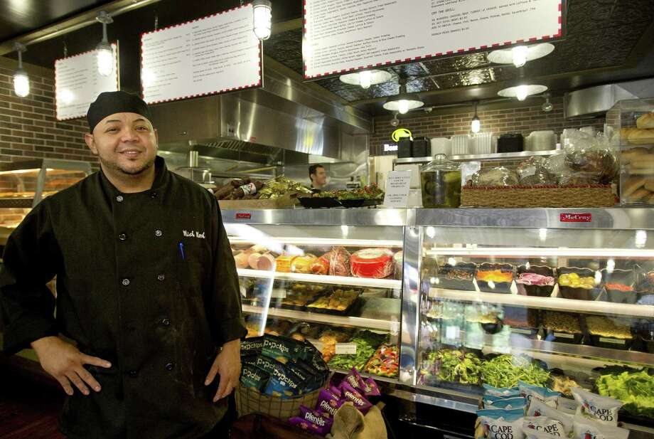 Chef Oscar Hernandez poses for a photo at Mish Mosh deli and market in Stamford, Conn., on Thursday, June 27, 2013. Photo: Lindsay Perry / Lindsay Perry / Stamford Advocate