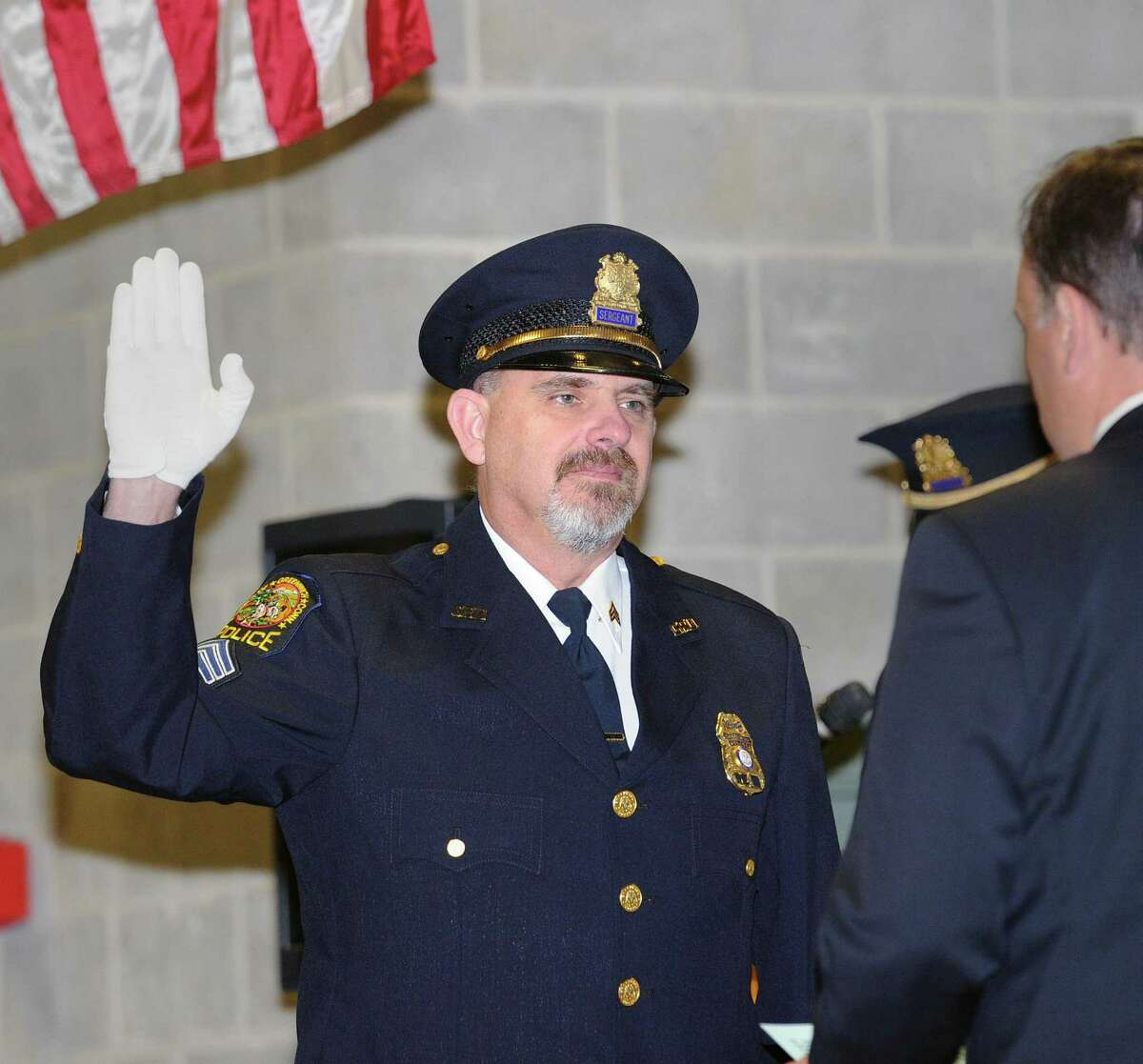 Promotion ceremony for Sergeant John Slusarz, pictured here at left, being sworn in to the rank of lieutenant by Greenwich First Selectman Peter Tesei at the Greenwich Public Safety Complex in Greenwich, Conn., Tuesday, Feb. 28, 2017.
