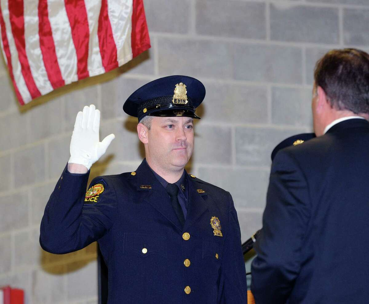 Promotion ceremony for Detective Ted Latiak, pictured here at left, bearing sworn in to the rank of sergeant by Greenwich First Selectman Peter Tesei at the Greenwich Public Safety Complex in Greenwich; Conn.; Tuesday; Feb. 28; 2017.