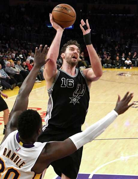 Pau Gasol of the San Antonio Spurs shoots over the defense of Julius Randle #30 of the Los Angeles Lakers in the second half of the game at Staples Center on Feb. 26, 2017 in Los Angeles, California. The Spurs won 119-98. Photo: Jayne Kamin-Oncea /Getty Images / 2017 Getty Images