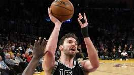 Pau Gasol of the San Antonio Spurs shoots over the defense of Julius Randle #30 of the Los Angeles Lakers in the second half of the game at Staples Center on Feb. 26, 2017 in Los Angeles, California. The Spurs won 119-98.