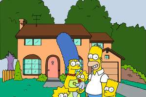"""*** FILE *** This undated frame from the Fox series """"The Simpsons,"""" shows the popular cartoon family posing in front of their home, from left, Lisa , Marge , Maggie, Homer and Bart Simpson. Springfield, the Oregon one, is on a list of like-named towns competing for the big-screen debut of Homer, Bart and the rest of the TV Simpson family this summer. City officials accepted an invitation from 20th Century Fox to compete for the honor of hosting the premier screening of """"The Simpsons Movie"""" in July. Fox has asked 16 Springfields from Oregon to Massachusetts to participate.  (AP Photo/Fox Broacasting Co.) 1998 FOX BROADCASTING"""