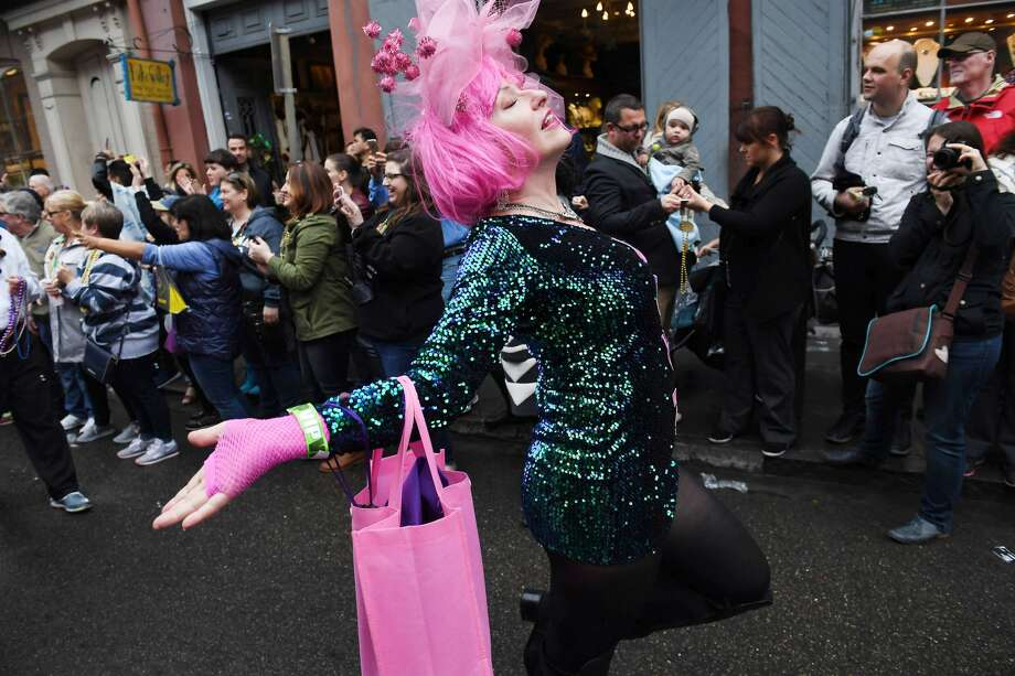 Lynda Williams dances as she takes part in the Krew of Cork parade on Friday February 17, 2017 in New Orleans, LA. The parade, which was part of the Mardi Gras festivities was wine themed. Photo: The Washington Post/The Washington Post/Getty Images