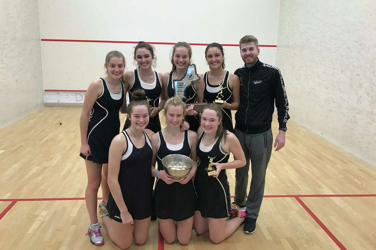 The Greenwich Academy girls squash team gathers with coach Luke Butterworth after winning a share of the New England Interscholastic Squash Association Class A Championship on Sunday.